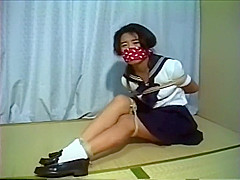 Tied and gagged school girl struggle
