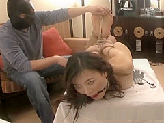 A sexy looking Asian hottie gets stimulated during bondage