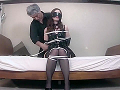 Japanese bondage girl in stockings tied and fucked