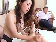 Babe with stockings sucks cock while second guy is watching