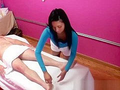 Naughty asian slut blows her clients hard cock during the massage