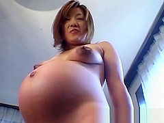 This pregant slut shows off her body and all her good bits