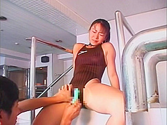 Asian swimsuit girl sucks her coaches dick