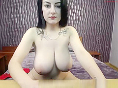 Skinny big tits brunette posing on webcam