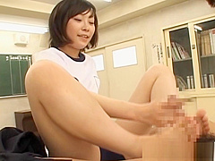 Shy Japanese girl in college giving footjob in classroom
