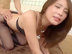 Slender asian Haruka Sasaki fucks wearing high heels and black stockings.