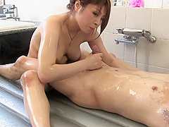 Girl in stockings gives guy a sensual massage with her body