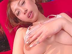 Oriental hottie fucks with sex toy